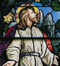 Stained glass window of Jesus praying